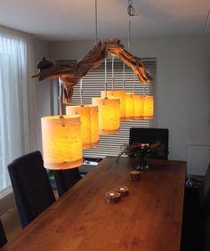 Plafondlamp van verweerd oud Eiken tak, prachtig bewerkt tot sfeervolle verlichting voorzien van 7 echt hout fineer lampenkappen. Lengte 220 cm. Kijk op  made by GBH NatureArt. Www.etsy.com/people/gbhnatureartnl
