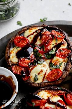 Caprese Stuffed Garlic Butter Portobellos! Garlic butter portobello mushrooms stuffed and grilled with fresh mozzarella cheese, grape tomato slices and drizzled with a rich balsamic glaze! | https://cafedelites.com