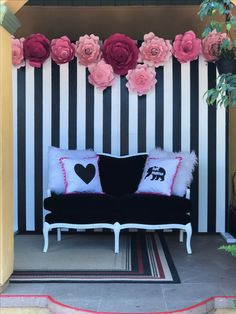 Black and white backdrop with paper flowers and a black velvet vintage sofa. Kate Spade theme for a photo booth area. Created by Chic Pink Petals Designs and Events.