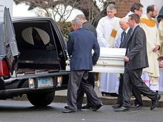 Pallbearers bring the casket of Jessica Rekos,  6, of Newtown to the hearse during her funeral at the St. Rose of Lima Roman Catholic church Tuesday morning December 18, 2012. Rekos was killed by a gunman who also claimed the lives of 6 adults and 19 other children at the Sandy Hooky Elementary School shooting Friday, December 15, 2012.   (Peter Hvizdak/ New Haven Register)