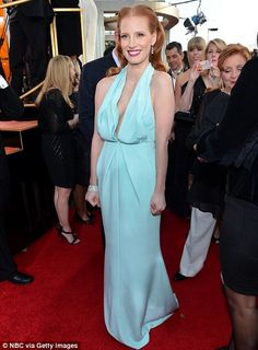 Jessica Chastain looked beautiful in a daring, plunging sky blue dress at the Golden Globes red carpet. #cleavage