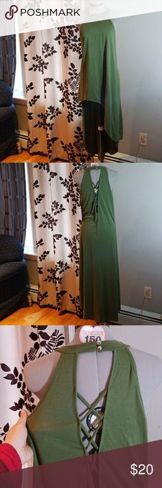 NWOT Topia 1x Green Asymmetrical Halter Dress Trendy and comfortable dress. Lacing detail along back. Asymmetrical design. Olive green. NWOT. Size 1x. Two buttons at back if neck. Halter. Perfect for summer! Bundle for an offer. Bundle and save. Smoke free, pet friendly home. 42 to 46 bust. Topia Dresses Asymmetrical