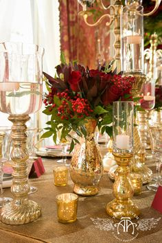 Gold accents with red floral create a romantic tablescape