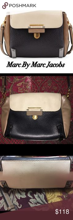 🆕Marc by Marc Jacobs Sheltered Island Crossbody Super cute MBMJ Crossbody with adjustable strap. all of the leather is in tact and excellent condition, however on the cream colored part there are a few spots mostly on the bottom and in the back from wear. One small spot on front cream part; most is not noticeable when worn b/c it's on the back and bottom; inside is clean. The chrome part has tiny areas tarnishing to reveal copper color. All imperfections can be fixed at the cobbler. Has…