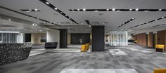 LEMAYMICHAUD | Quebec | Conference Hall | Architecture | Design | Seating | Carpet | Windows | Natural Light | Black | Gray | Yellow | White | Concrete
