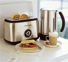 Kettle and toaster are two necessary kitchen appliances in each and every home. Thus, I always think that they are the best gift idea for any. Kettle And Toaster Set, Bread Toaster, Domestic Appliances, Sofa And Loveseat Set, Contemporary Coffee Table, Pick One, Cool Kitchens, Best Gifts, Kitchen Appliances