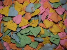 Pastel assortment of heart shaped seed bombs for beach themed wedding favors