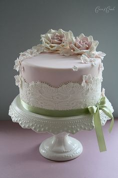 Softly muted pastel and lace birthday/anniversary cake by skilled cake designer Tracy James of Cotton and Crumbs, Coventry, England....