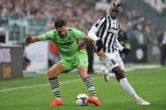 Paul Pogba (R) of Juventus competes with Nicolo Cherubin  of Bologna FC during the Serie A match between Juventus and Bologna FC at Juventus...