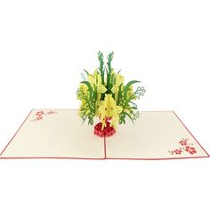 Flower Splendor Pop-Up Card. The outside of this card illustrates a beautiful bouquet of flowers that are laser cut on the red cover with real life detail.  Upon opening the card, a pop up celebration unfolds that will leave your loved ones speechless.  With a black vase and red and yellow flowers springing to life, this pop-up card will start a conversation and become a collectible treasure.  Let us help you unfold a memory with those you hold most dear.