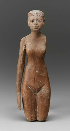 Wooden female figurine. Middle Kingdom. Late 11th - 12th dynasty. 2008–1783 B.C…