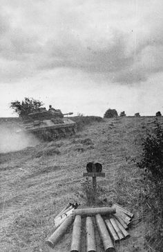 1st Polish Armoured Division passing a grave during the Battle of Falaise Pocket