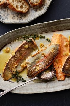 NYT Cooking: Here is a recipe for trout like the one we ate in Maine. I now add garlic cooked in olive oil, because I have watched enigmatic Basques add it to regal white hake they cook above coals burned from oak. It goes well with the simple trout's innate subtlety and faint whiff of wood smoke, and it all ends up resolutely likable.  This takes only a few minutes,%...