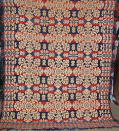 "ca. 1844; blue and red wool and white cotton coverlet having self-fringed sides, applied fringe on bottom and a rolled top hem by Joseph Deavler for Hess, 100""x 75"";"