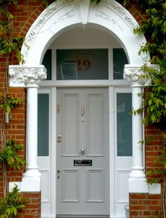 glass panel above with number. the door would look bigger if all the wood surround was painted the same colour. Victorian Front Doors, Victorian Porch, Grey Front Doors, Front Door Porch, Porch Doors, Edwardian House, Front Door Colors, Glass Front Door, House Front