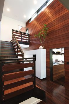staircase with wood stairs, wood rails, wood covered wall of Warming Your Room with Wood Wall Covering