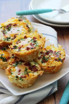 """Fill the spaces in a muffin tin with hashbrowns to create little """"nests"""" for your eggs, bacon, and cheese. Get the recipe at The Cooking Jar."""