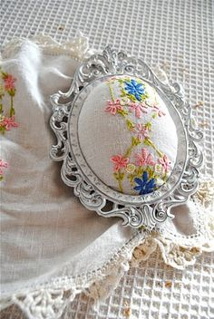vintage embroidery pincushion in repurposed frame