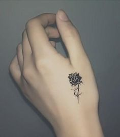 Such a sweet little rose tattoo....the placement is just right :)!