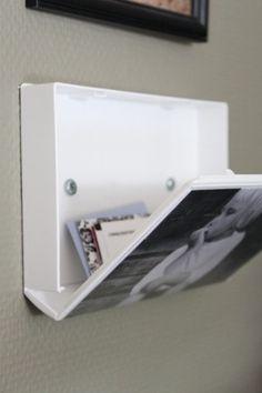 Use una cubierta vieja de VHS como un marco de fotos con almacenamiento oculto. pinterest, nunca dejas de sorprenderme ...