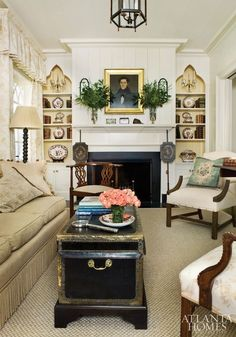 love the chest, the lamp and the built-in shelves in this tiny drawing room, but i'd lose the furnishings for something a bit more inviting and replace the decorator touches with a more eclectic style.