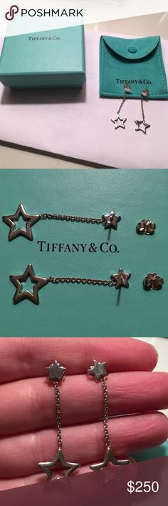 """Tiffany Star Dangle Earrings  100% authentic Tiffany and Co. sterling silver star drop earrings. Comes with original backs which are marked """"925"""" and """"T&Co"""". These earrings are incredibly rare and are no longer being made. Purchased in 2006 and have been worn infrequently and kept in the pouch. The earrings will be shipped with the pouch and Tiffany box. One earring does not lay entirely flat but is not noticeable (left in last picture). Tiffany & Co. Jewelry Earrings"""
