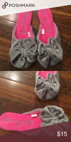 Cute house slippers with big grey bow Adorable house slippers. Never been worn. They are a size small but will fit a size 5.5-6.5 patricia green  Shoes Slippers
