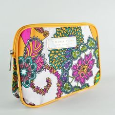 Trina Turk For Clinique Makeup Bag by Clinique. $18.50. Dimensions - Length - 9 1/2 Inches; Height - 7 Inches; Width - 2 Inches.. Fantastic bag for cosmetics, beautiful colors