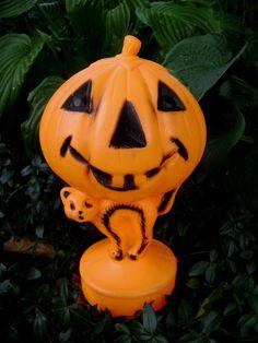 Vintage Halloween Plastic Jack O Lantern and Black Cat, Trick or Treat, Spooky Decor, Pumpkin, Orange and Black. $24.95, via Etsy.