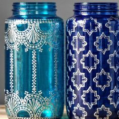 Mason Jar Vase, Boho Home Decor with Silver Metal Accents, Choose From Three Brilliant Glass Shades and Henna Designs  This listing is for one 32 oz (quart sized) hand painted mason jar vessel. You choose from the three jars pictured, either teal glass, cobalt glass, or blueberry glass. See a design you like but want a different glass color? No problem! Just choose the jar with the design you like, then leave me a message during checkout letting me know your glass color preference.  These…