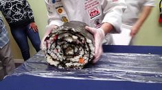 Student Chefs Prepare an Enormous Sushi Roll for the 2016 Japanese Food Festival in Los Angeles