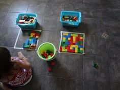 Spatial puzzle by putting a tape square on floor and having child fill it in with blocks