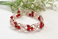 Allow me to show you the final look of this love red and pink crystal dancing clover bracelet!