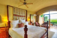 These comfortable en-suite rooms with air-conditioning and minibar all have river views and large terraces with views over the Chobe Park – the safari never stops. Terrace, Safari, Curtains, Bed, Room, Furniture, Home Decor, Balcony, Bedroom
