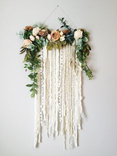 My heart is exploding for this piece. This is my first in a line of fiber art floral design wall hangings, and it screams to me THE SECRET GARDEN. This piece is approx. 44 vertical (from top of flowers to bottom of extensions) and 25 across. A variety of multi-textured yarns hang