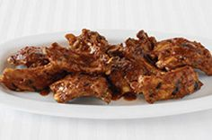 Orange marmalade and chipotle peppers add some sweet heat to these barbecued ribs.  Saucy, tender and succulent, these Easy Chipotle Barbecued Ribs are a must-try recipe.