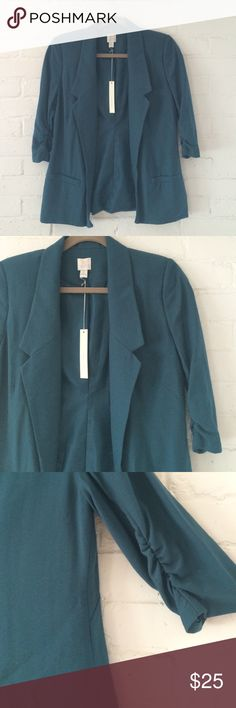 LC Lauren Conrad Teal Relaxed Fit Blazer This blazer features an open front and 3/4 ruched sleeves for a very casual look. Like a long cardigan/blazer lovechild. Very cute and comfortable. New with tags! never worn! LC Lauren Conrad Jackets & Coats Blazers