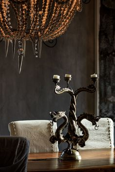 Check out our collection of eclectic boutique hotels all over the world and choose the one that speaks to you the most. Bohemian Chic Decor, White Patterns, Hotels, Chandelier, Ceiling Lights, Black And White, Wood, Inspiration, Home Decor