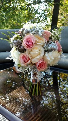 Gorgeous fall wedding. Geraldine roses, dusty miller, blizzard roses, wax flower, dahlias, silver brunia. Made by Always N Bloom