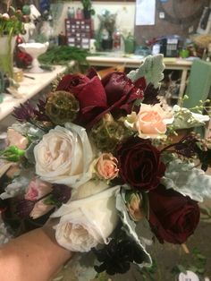 Winter elegance . Professional florist . Pale pink dark Marsala wine and white . Classic and elegant .  Www.willowsbywehr.com 330.;482.2223
