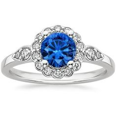 Platinum Sapphire Camillia Diamond Ring (but without the ring around the stone, just the side tear drops)