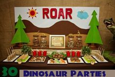 This cute dessert table makes use of bright primary colors - who could be afraid of the dinosaurs at this party.