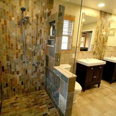 Bathroom remodel design ideas - ceramic tile I like the built ins for bottles and partial glass wall,open on one end so no shower door to clean