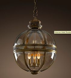 """restoration hardware light fixture from the victorian era (height of the industrial revolution and where much of what we consider """"industrial really is"""" i.e. steel, concrete, gas light, dark wood, leaded glass etc) ... when standing directly underneath and looking up it is like looking at the greek hairnet of gold"""