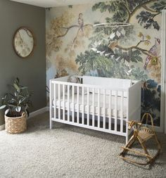 Don't you just want to run over to Anthropologie and scoop up this wall mural, stat? It quickly became the focal point for Claire Boeshaar when transforming a family guest room into her son Luke's nur