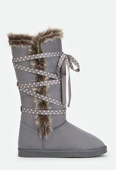 Lace-up in these soft and cozy faux suede boots featuring a faux fur lining and a lace-up detail. ...