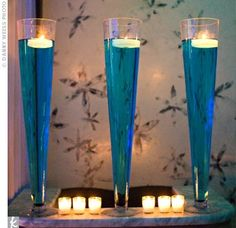 Ideas for Centrepieces with Tall Cylinder Vases : wedding autumn centrepieces cylinder vases fall ideas tall vases theme vases wine Centerpieces Wedding Candles Pictures 03 Blue Wedding Centerpieces, Floating Candle Centerpieces, Reception Decorations, Centerpiece Ideas, Candle Vases, Tropical Centerpieces, Modern Centerpieces, Candle Lighting, Centerpiece Flowers
