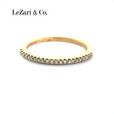 This elegant eternity band is an excellent selection for stack-able rings and engagement ring pairing.