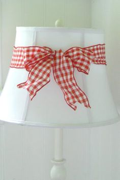 Red Gingham Lamp Shade: Add more color to your white lampshade by tieing colorful ribbon into a big  bow around,Lighting