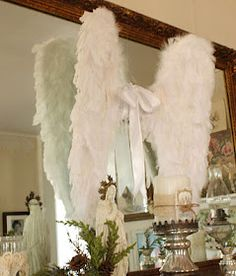 Angel wings. Would be cute hanging on the wall in a nursery.